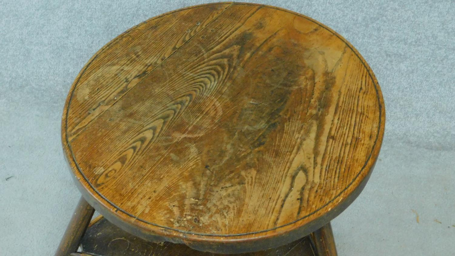 An antique elm circular topped cricket table on three circular section splayed supports united by - Image 2 of 4