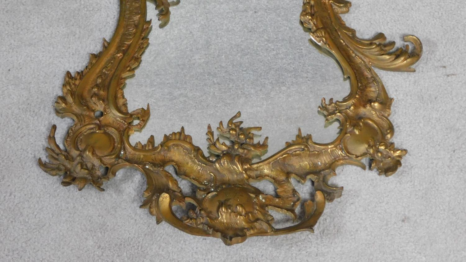 A Rococo style ormolu gilt brass mirror. Rocaille formed frame with wooden back. H.80xW.51cm - Image 3 of 3