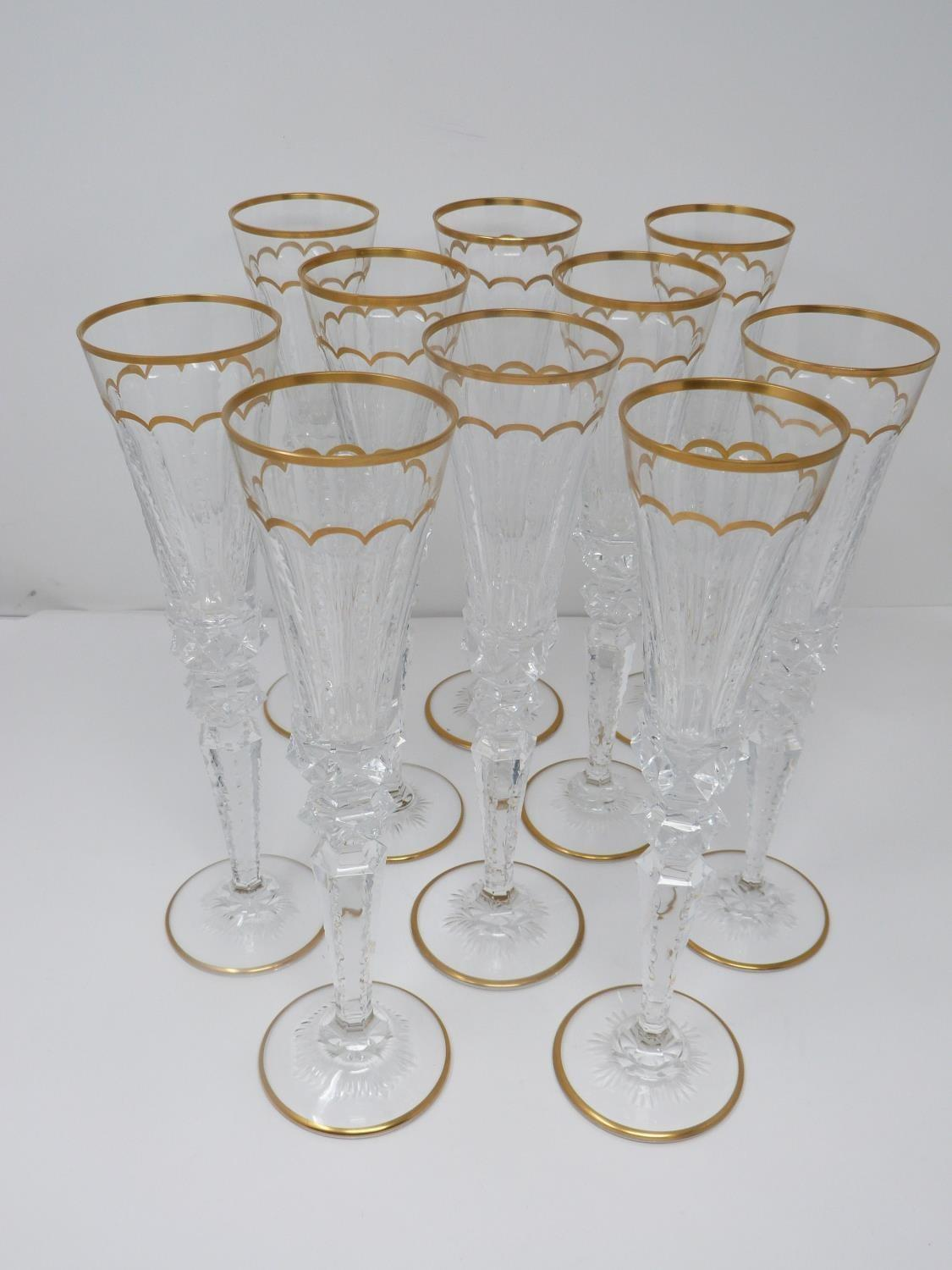 A set of ten St Louis Excellence crystal champagne glasses,with gilded scalloped detailing and - Image 2 of 6