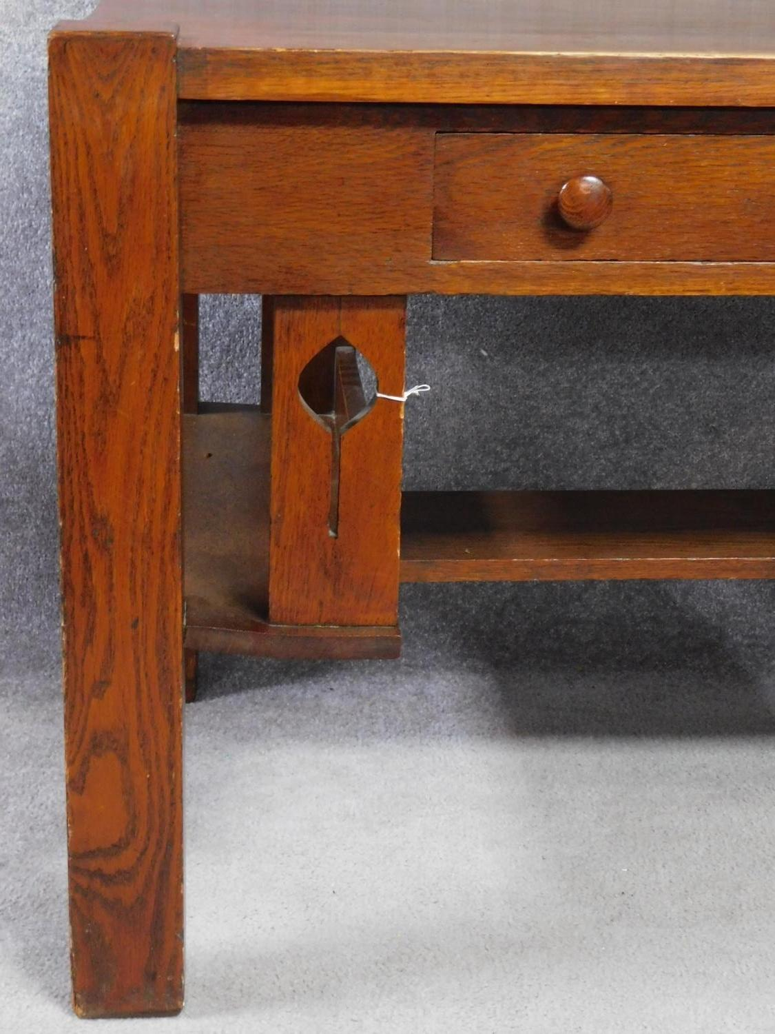 An American Arts and Crafts Mission style oak desk. Fitted with central frieze draw with book - Image 5 of 6
