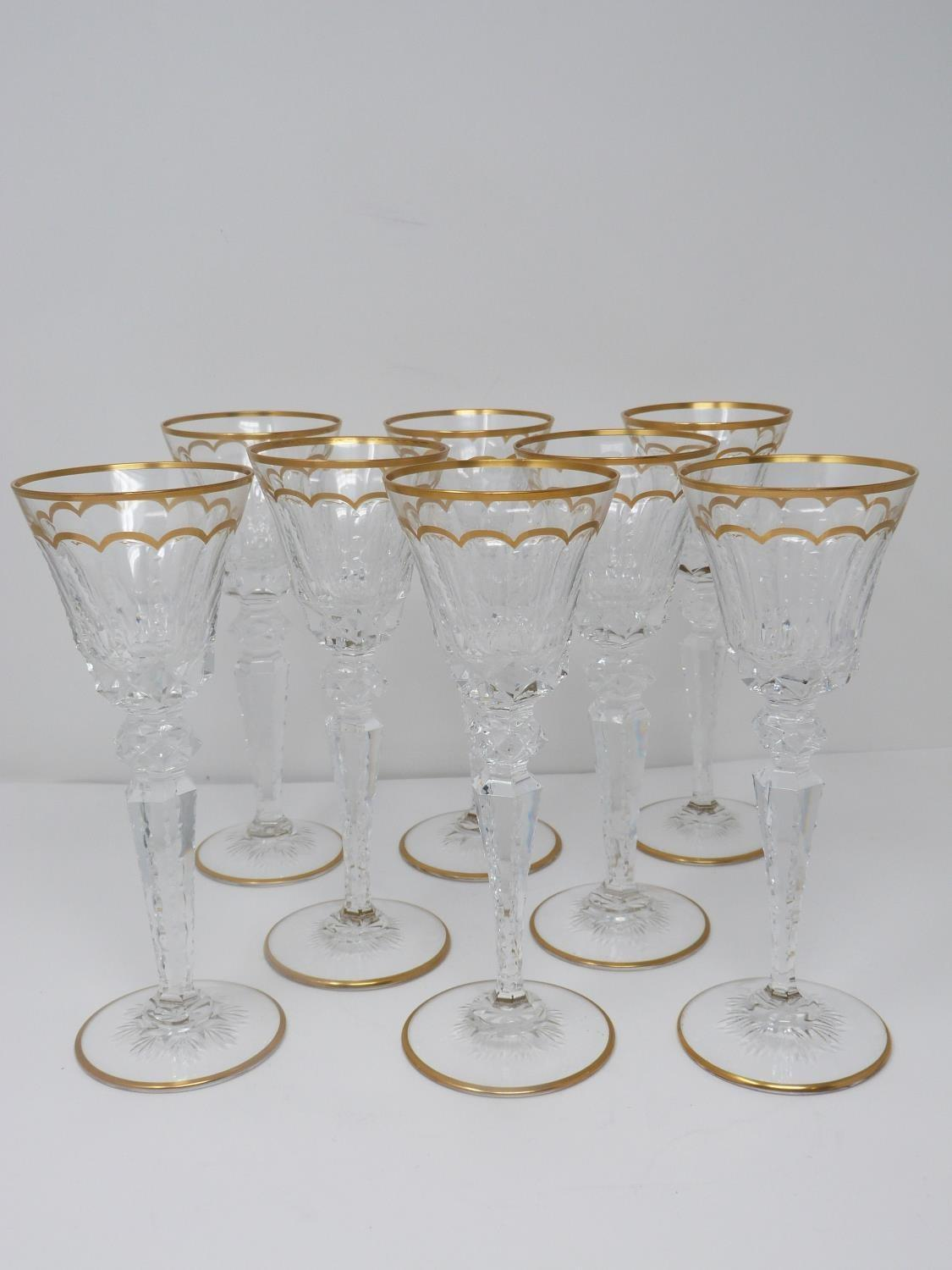 A set of eight St Louis crystal sherry glasses, with gilded scalloped detailing and gilded edge to
