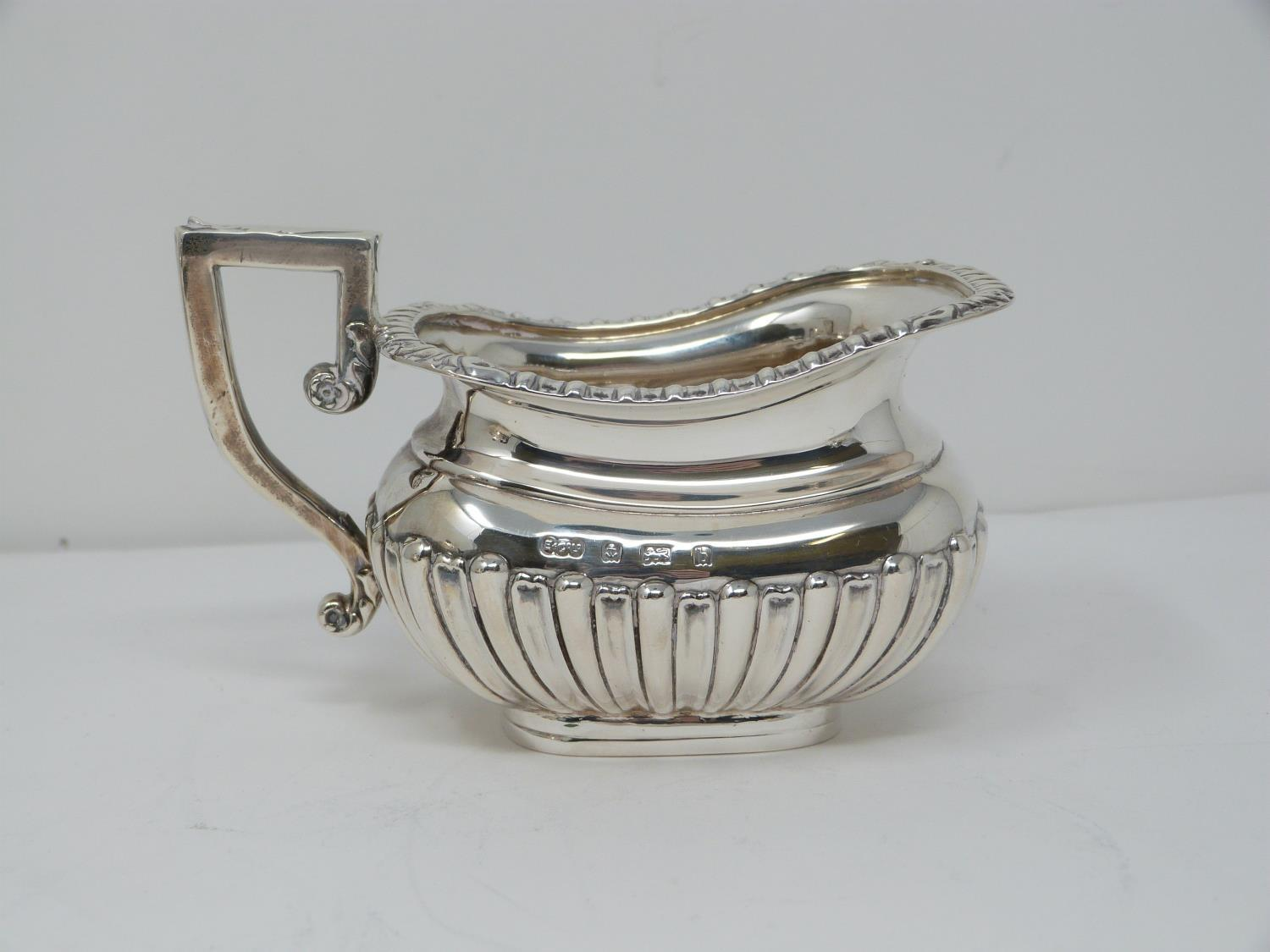 An Elkington and Co. silver three piece tea service, includes a teapot, sugar bowl and milk jug. - Image 8 of 12