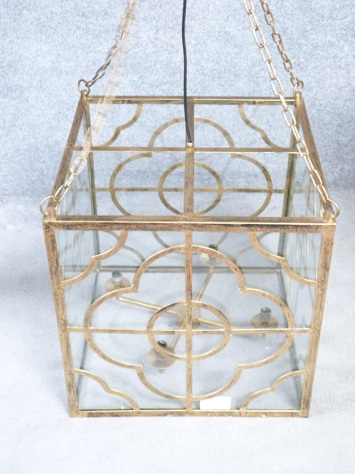 A Julian Chichester gold 'Anna' design pierced metal hanging ceiling lantern with stylised floral