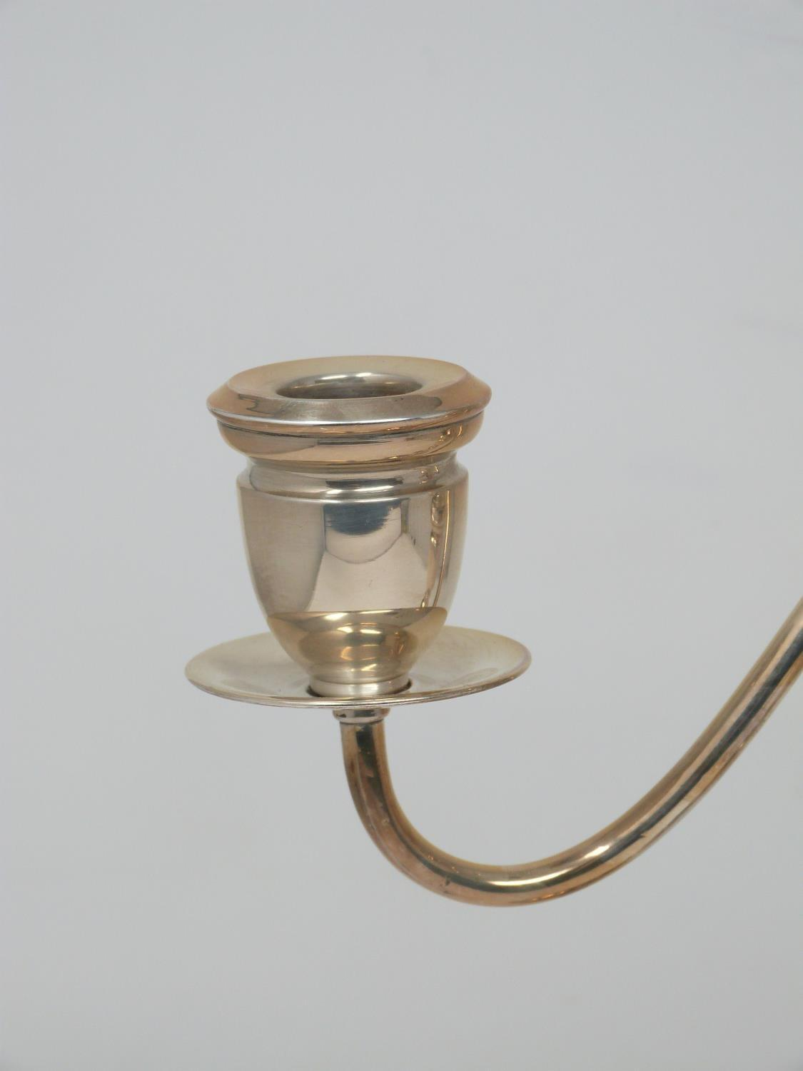 A continental silver three branch candelabra with weighted round base and twisted design. Stamped to - Image 4 of 6