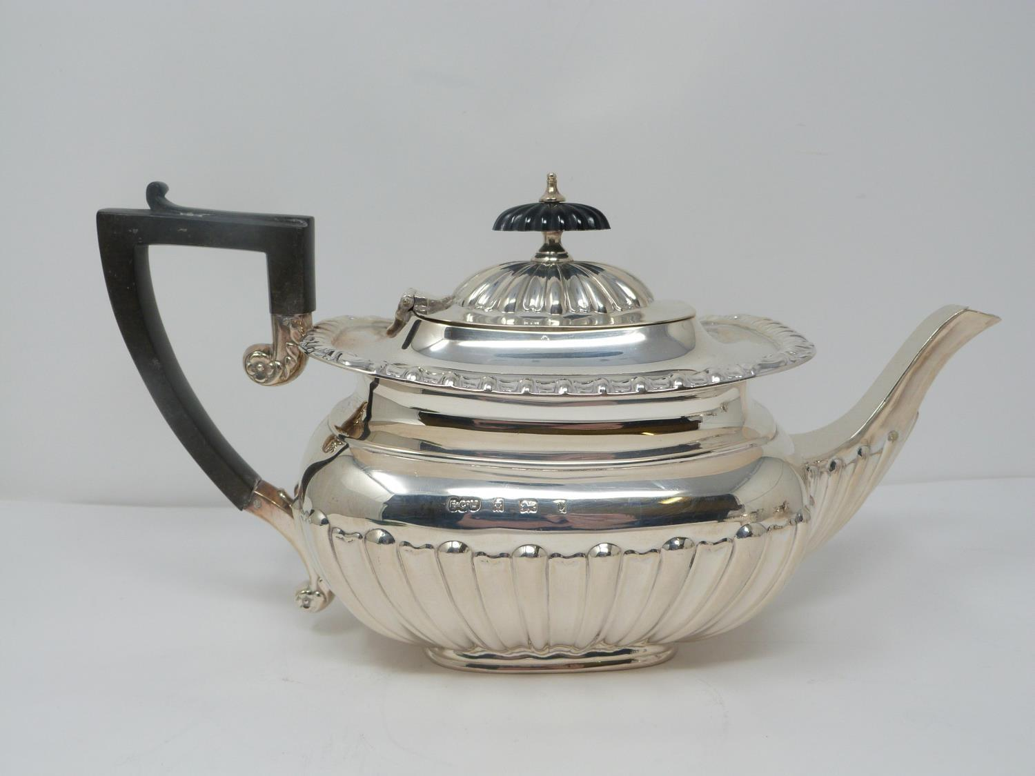 An Elkington and Co. silver three piece tea service, includes a teapot, sugar bowl and milk jug. - Image 2 of 12