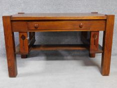 An American Arts and Crafts Mission style oak desk. Fitted with central frieze draw with book