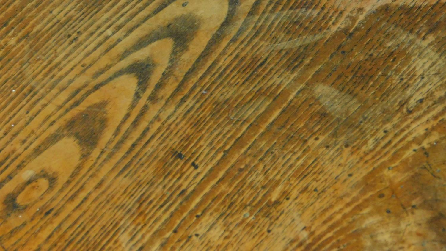 An antique elm circular topped cricket table on three circular section splayed supports united by - Image 4 of 4