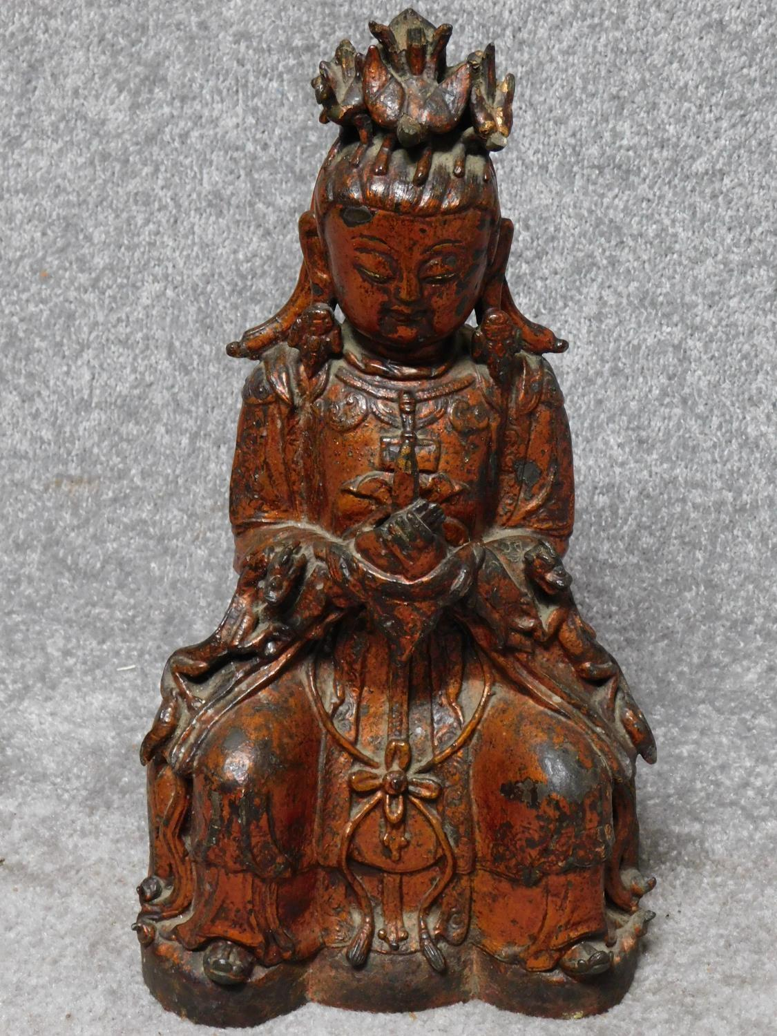 Possibly Ming dynasty Chinese gilt lacquered bronze seated figure of Guanyin. From a private