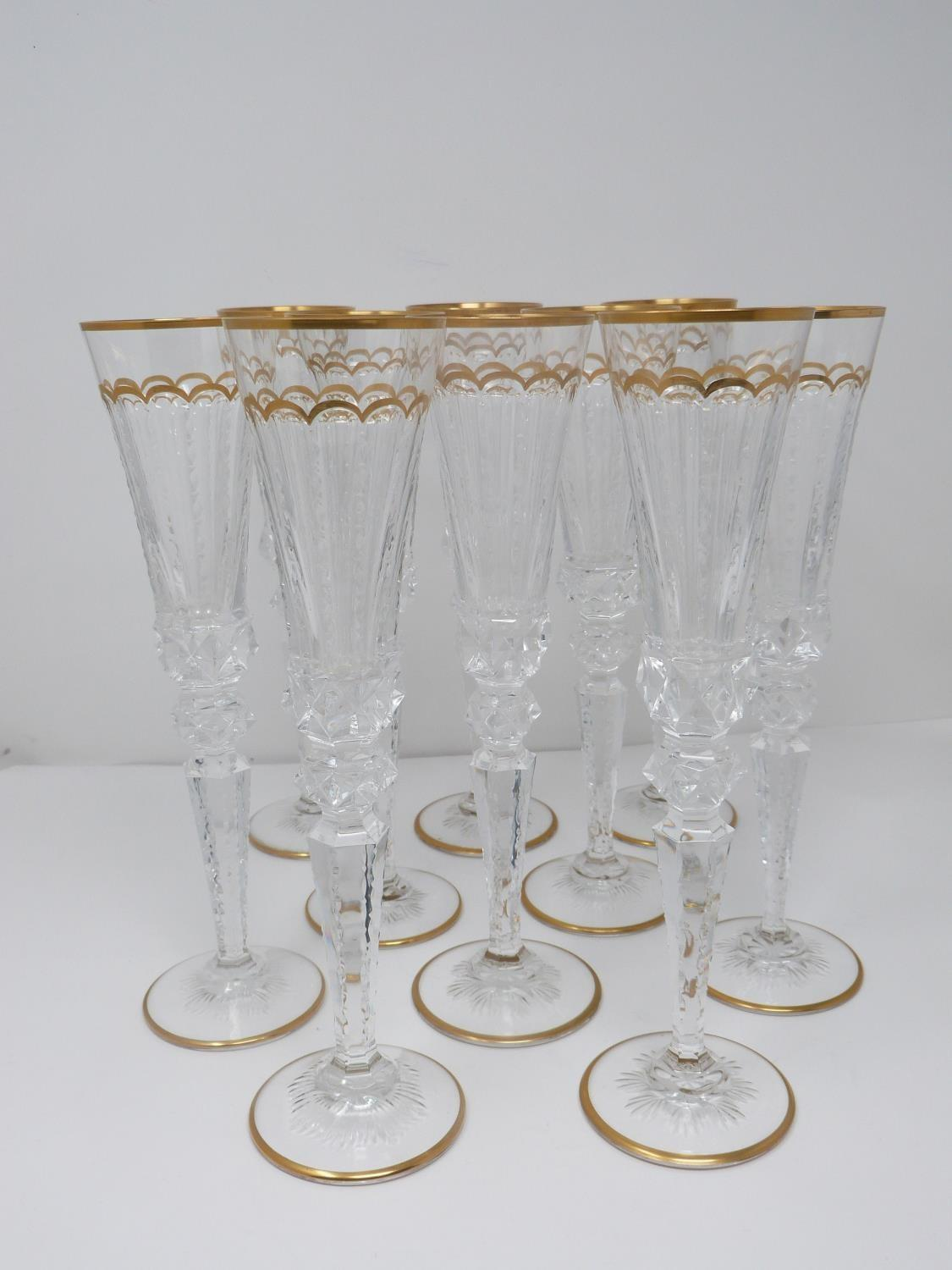 A set of ten St Louis Excellence crystal champagne glasses,with gilded scalloped detailing and