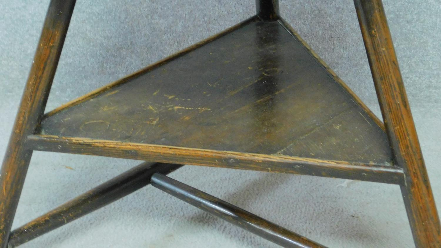 An antique elm circular topped cricket table on three circular section splayed supports united by - Image 3 of 4