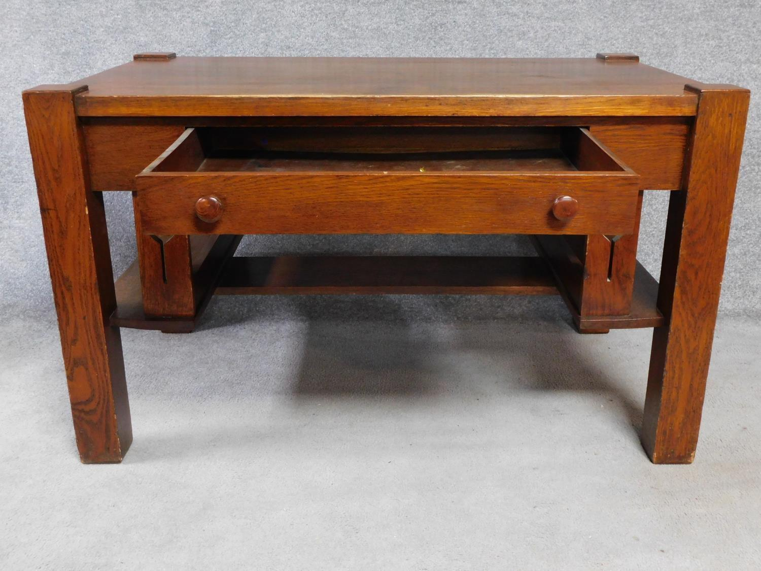 An American Arts and Crafts Mission style oak desk. Fitted with central frieze draw with book - Image 3 of 6