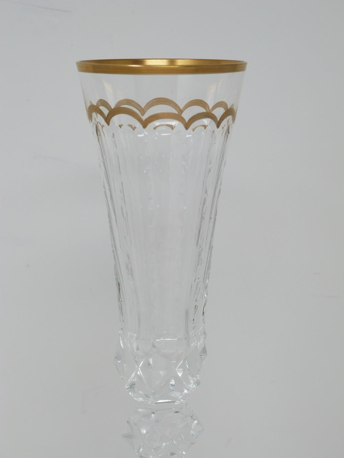 A set of ten St Louis Excellence crystal champagne glasses,with gilded scalloped detailing and - Image 5 of 6
