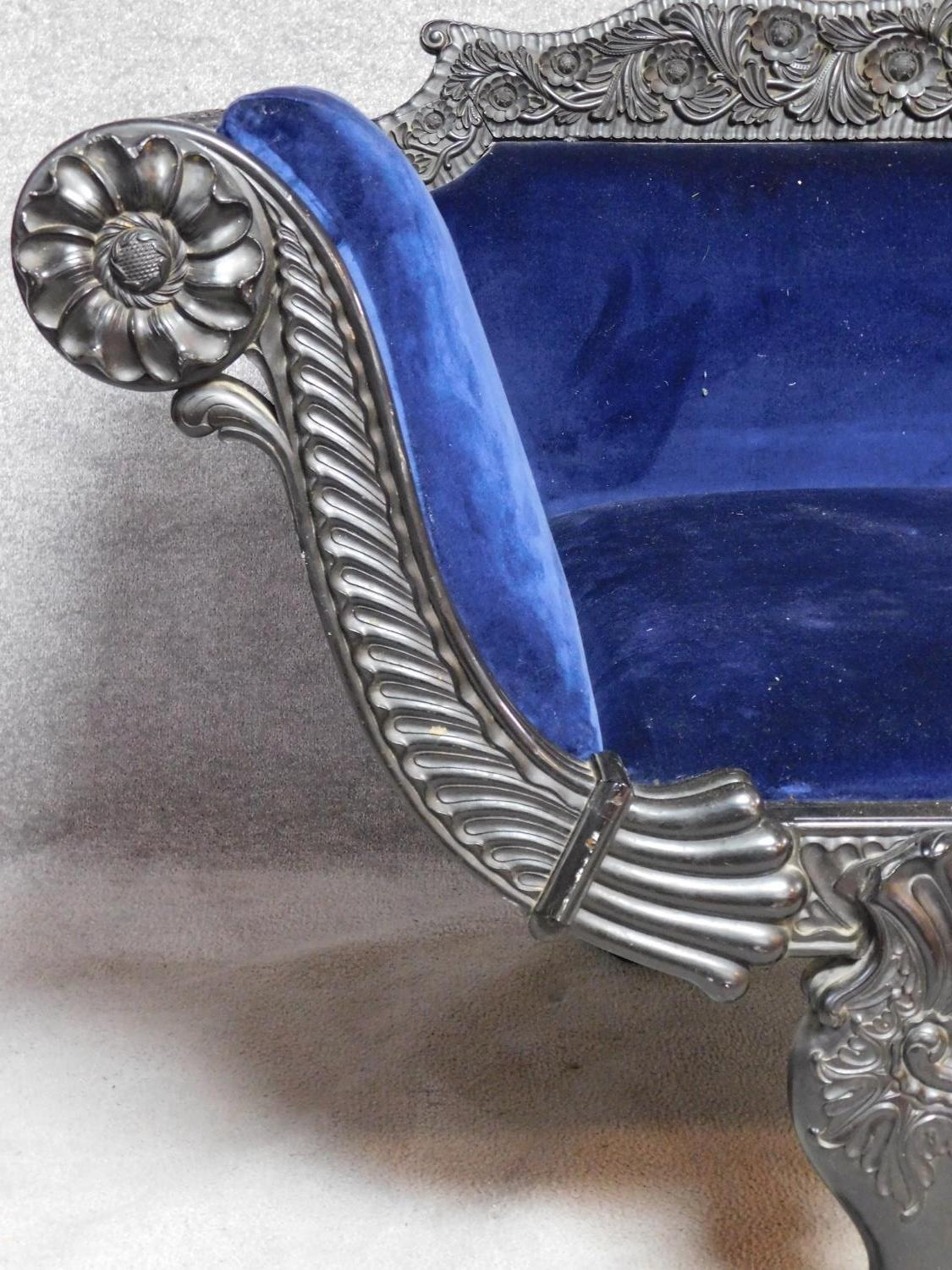 A 19th century Anglo Indian carved ebonised scroll end sofa with blue velvet upholstery on scroll - Image 4 of 9