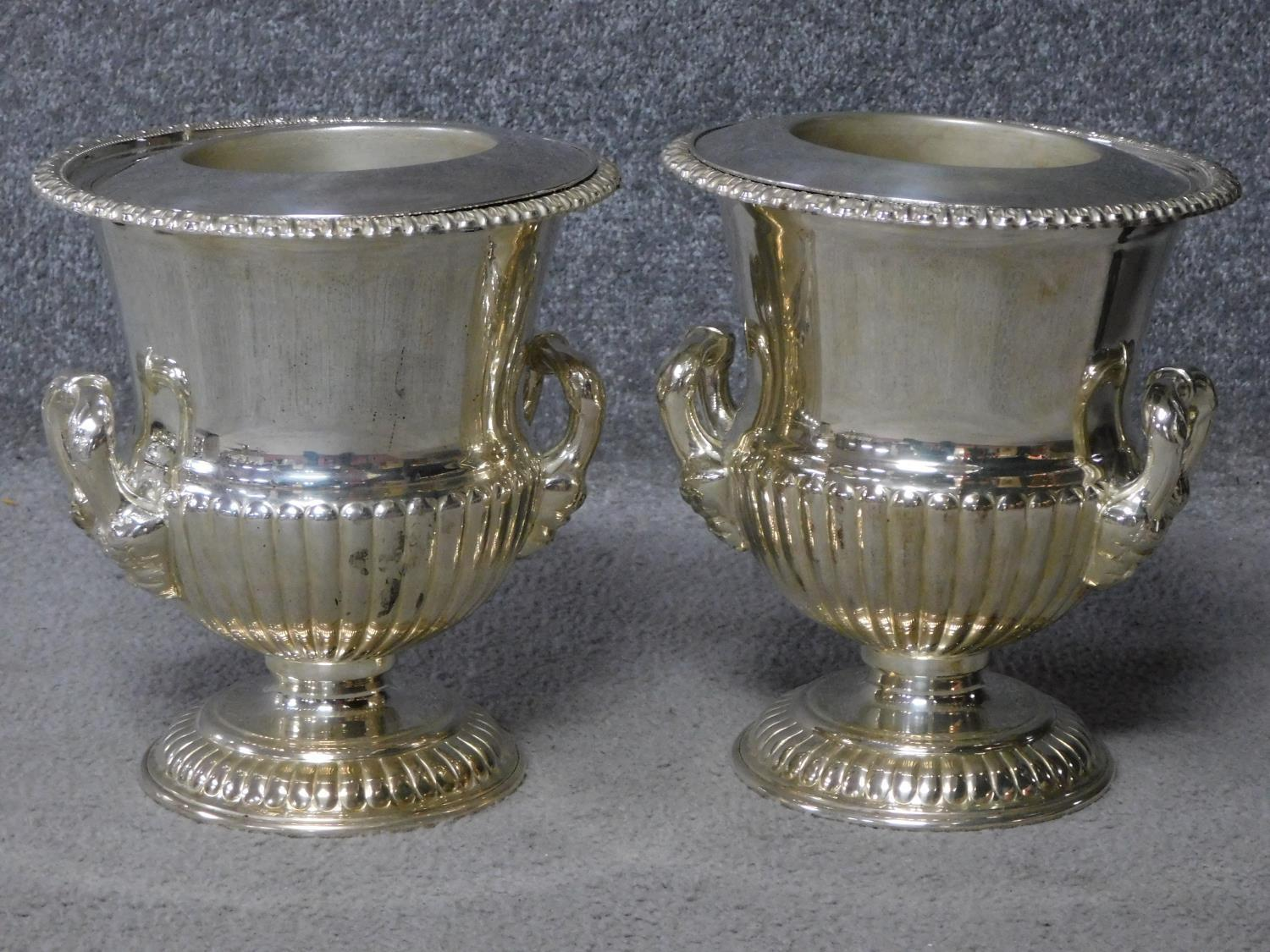 A pair of antique Old Regency Sheffield silver plated wine coolers by Henry Wilkinson and Co. with