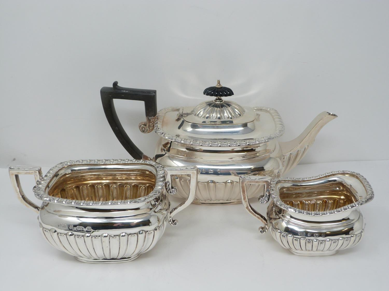 An Elkington and Co. silver three piece tea service, includes a teapot, sugar bowl and milk jug.