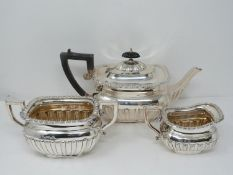An Elkington and Co. silver three piece tea service, includes a teapot, sugar bowl and milk jug.