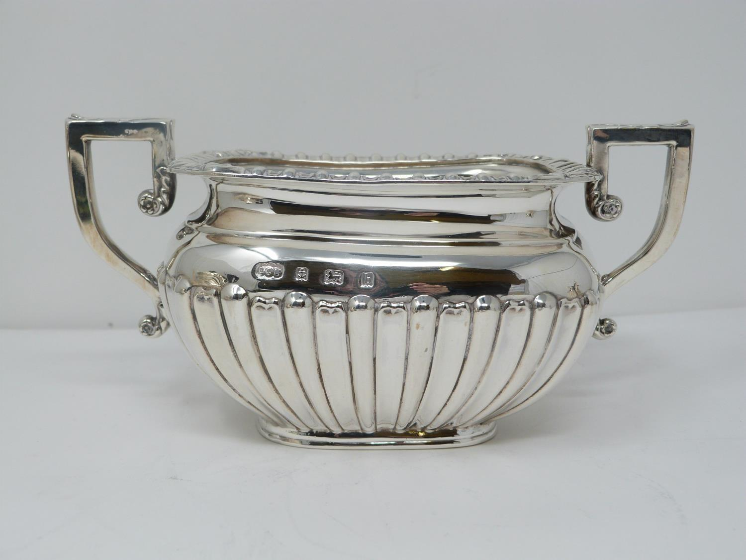An Elkington and Co. silver three piece tea service, includes a teapot, sugar bowl and milk jug. - Image 7 of 12