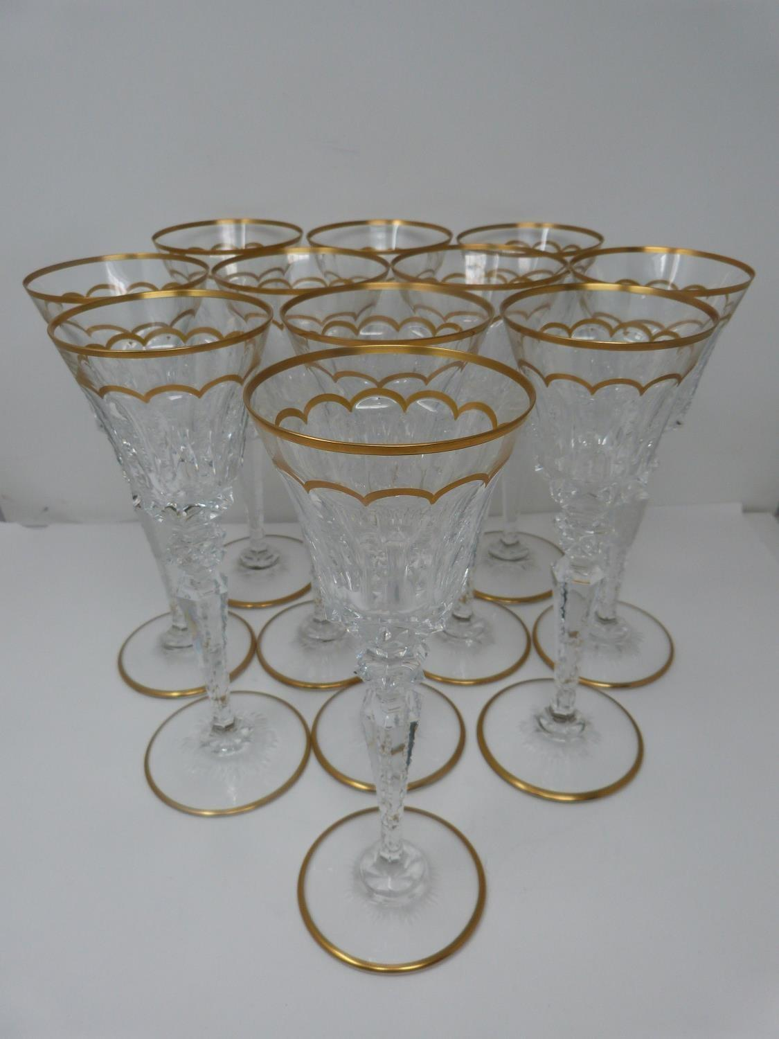 A set of eleven St Louis Excellence crystal large wine glasses, with gilded scalloped detailing