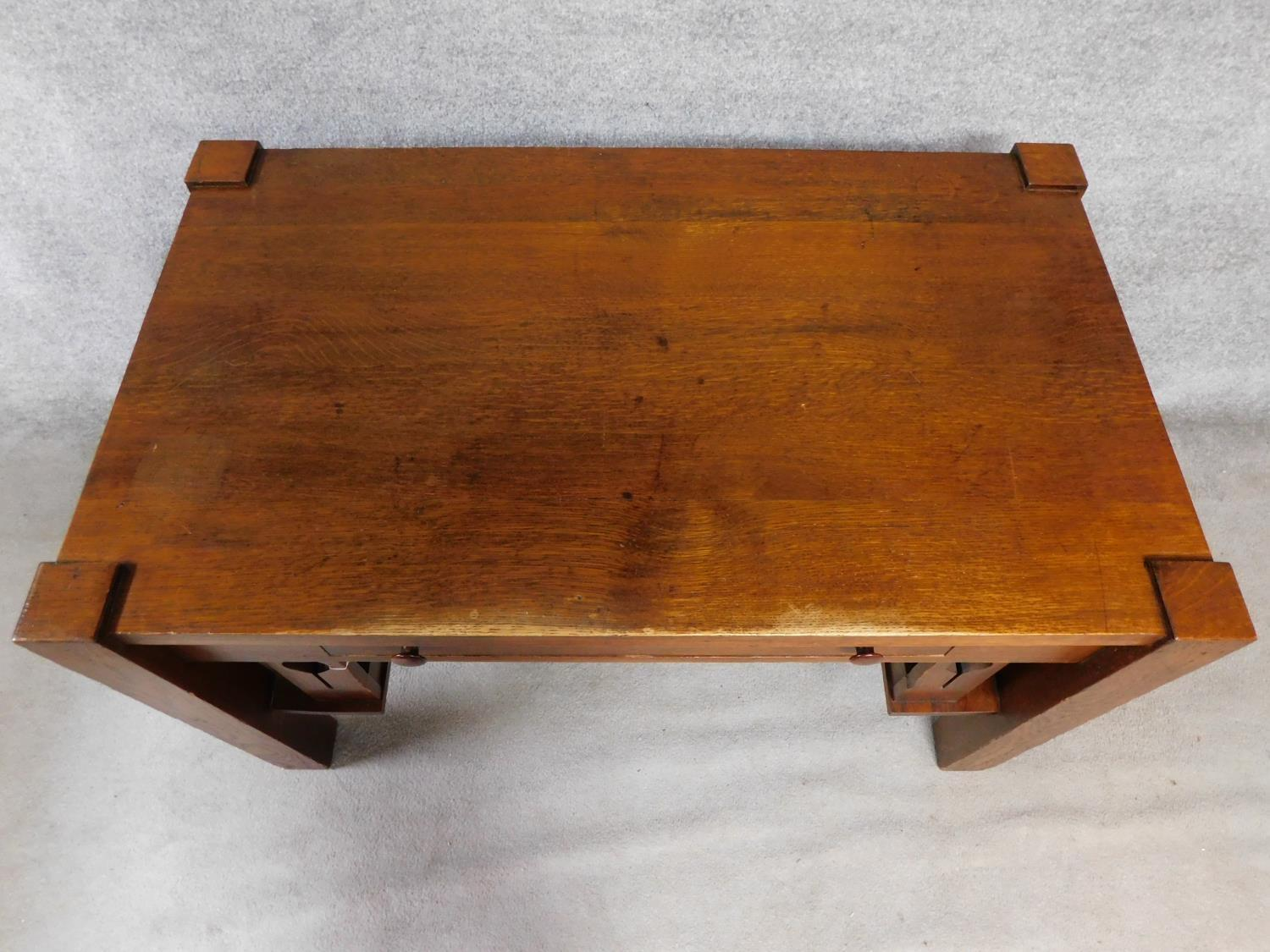 An American Arts and Crafts Mission style oak desk. Fitted with central frieze draw with book - Image 4 of 6