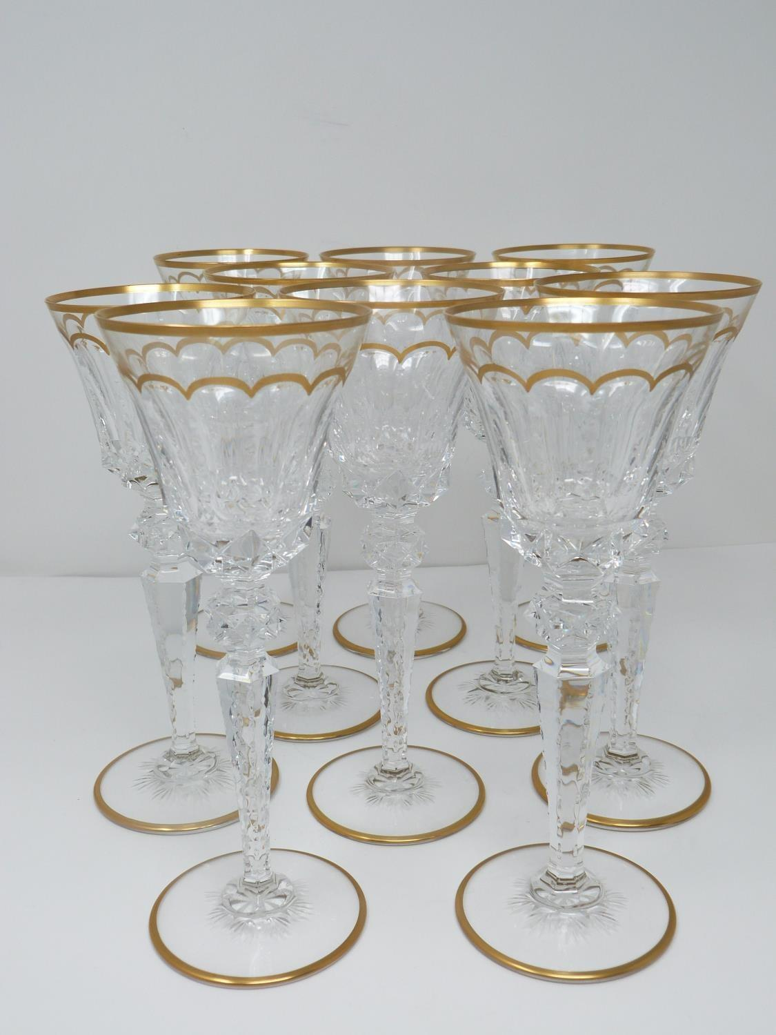 A set of ten St Louis Excellence crystal wine glasses, with gilded scalloped detailing and gilded