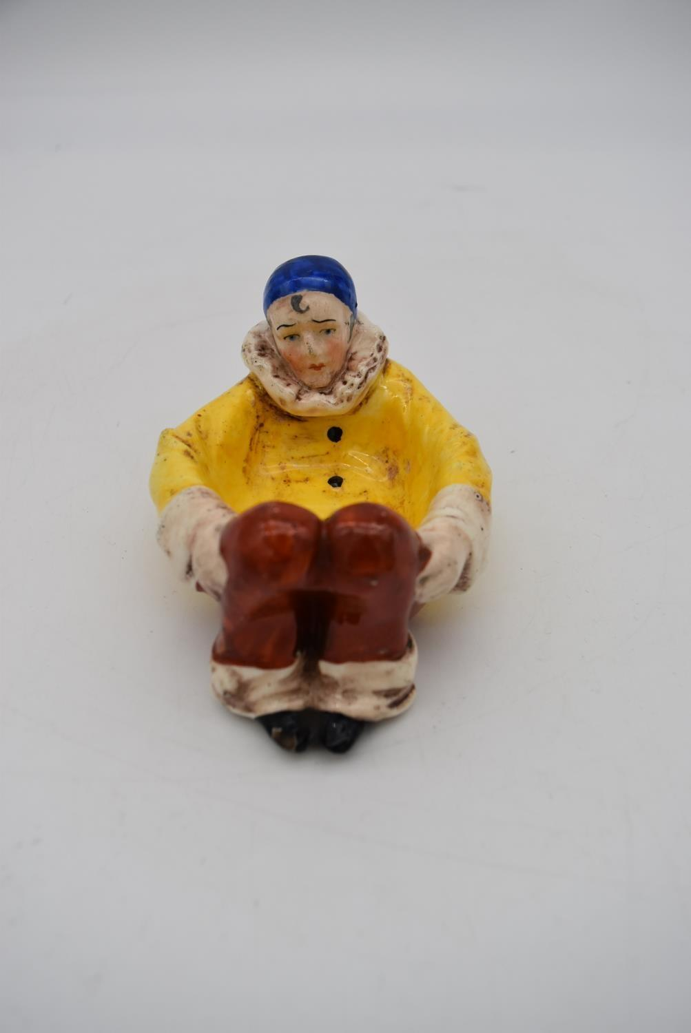 Two antique hand painted porcelain lying figures, one male clown and a female clown, used as dishes. - Image 4 of 9