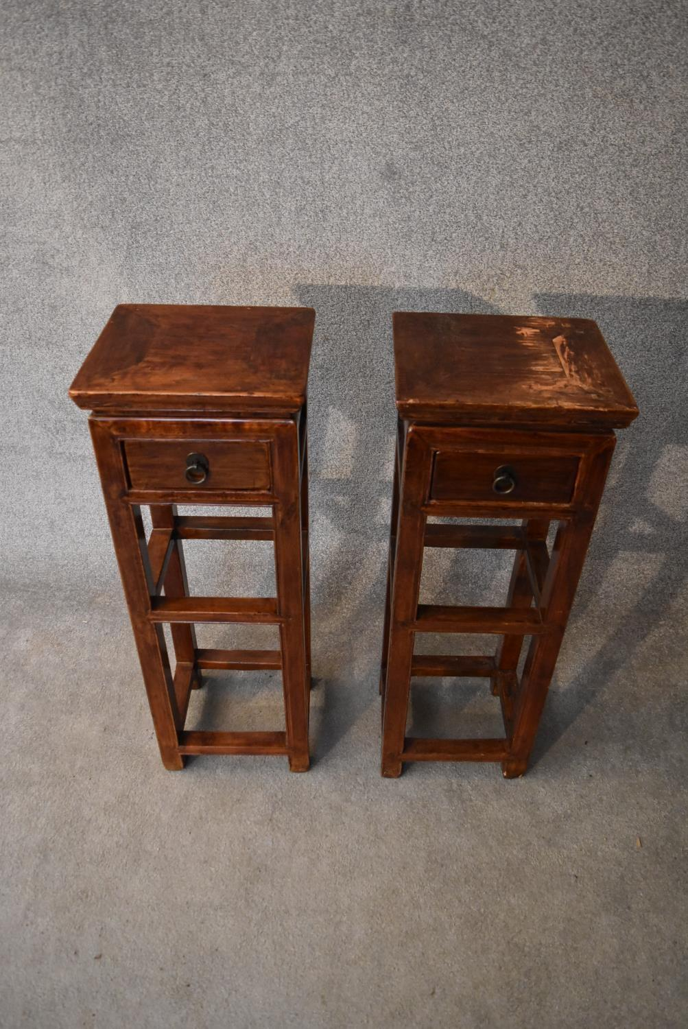 A pair of Chinese hardwood urn stands fitted frieze drawers. H.86x32cm - Image 2 of 4
