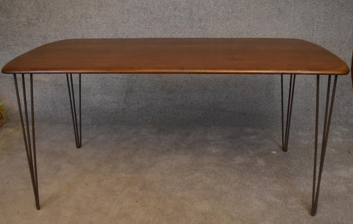 A retro style elm topped dining table on metal hairpin supports. H.73x150x76cm