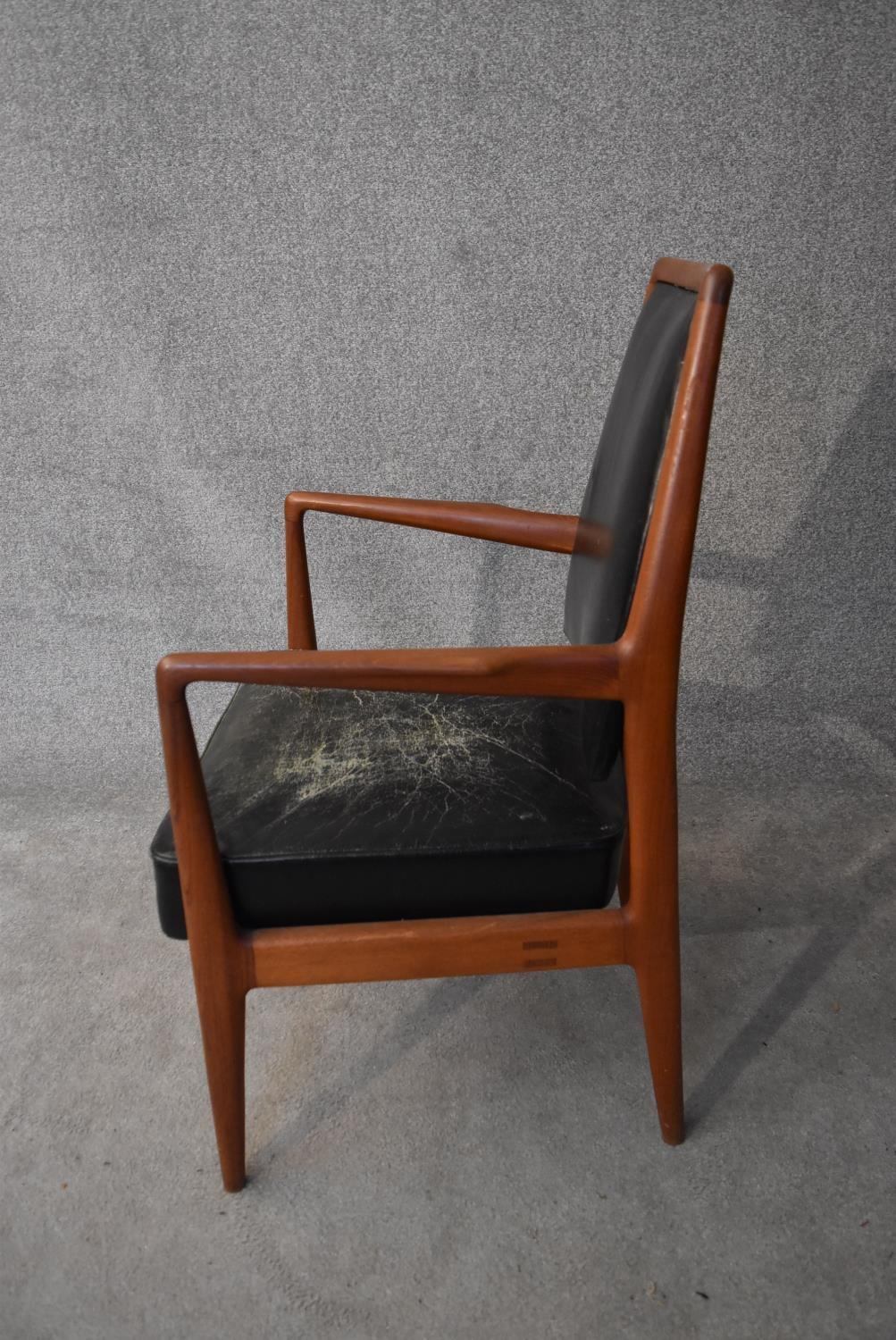 A mid 20th century vintage Danish teak framed armchair in leather upholstery. H.98x60cm - Image 4 of 4