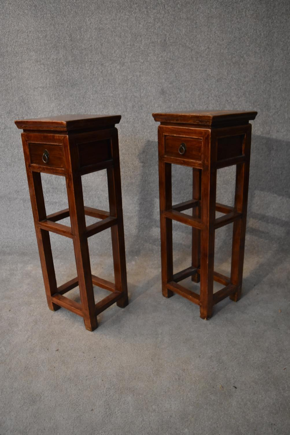 A pair of Chinese hardwood urn stands fitted frieze drawers. H.86x32cm - Image 4 of 4