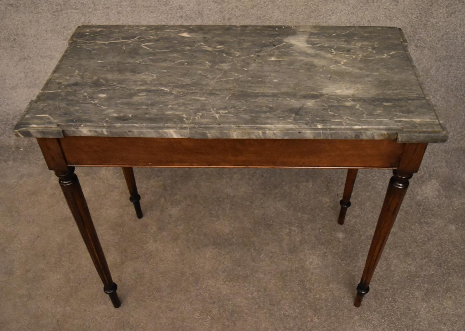 A 19th century mahogany console table with grey marble top on reeded tapering supports. H.75x82x43cm - Image 2 of 5