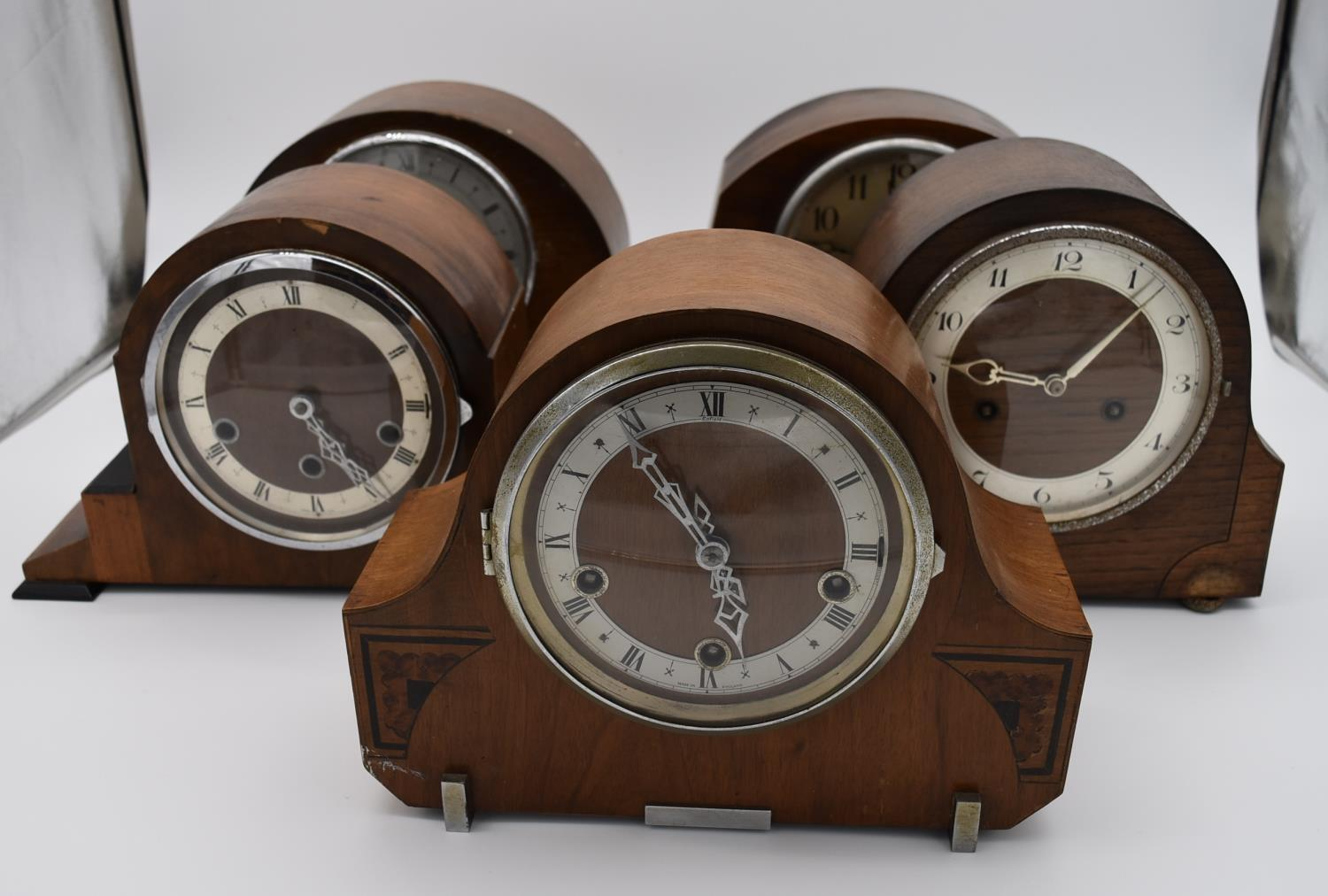 A collection of five mid 20th century mantel clocks with English brass movements. Some have roman