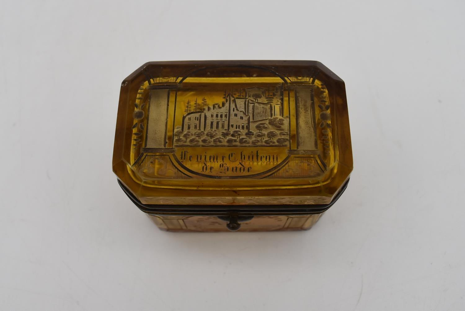 A small 19th century engraved amber glass and ormolu mounted box. H.7x8cm - Image 2 of 4