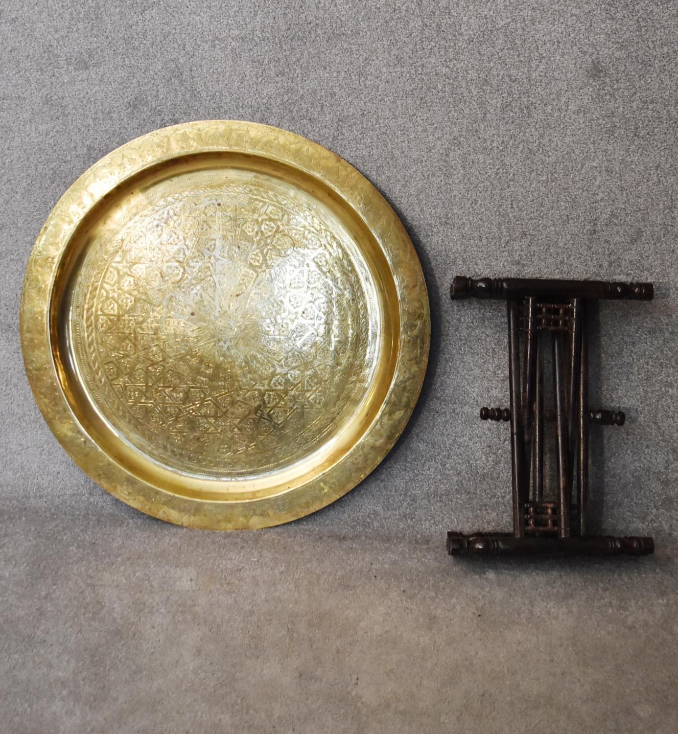 An Eastern brass topped table on folding hardwood stand. H.45xDia.90cm - Image 5 of 5