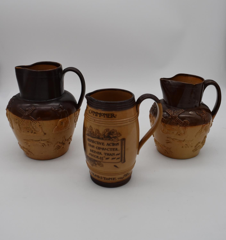 An antique Royal Doulton tobacco jar along with three antique salt glaze earthenware jugs. H.25cm - Image 2 of 6