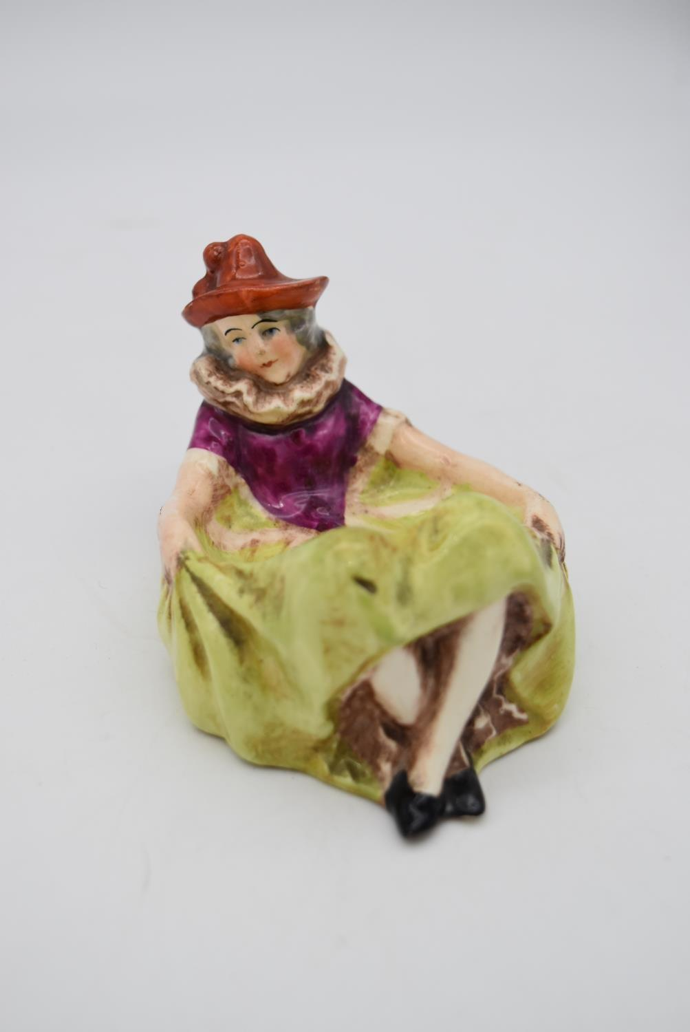 Two antique hand painted porcelain lying figures, one male clown and a female clown, used as dishes. - Image 7 of 9