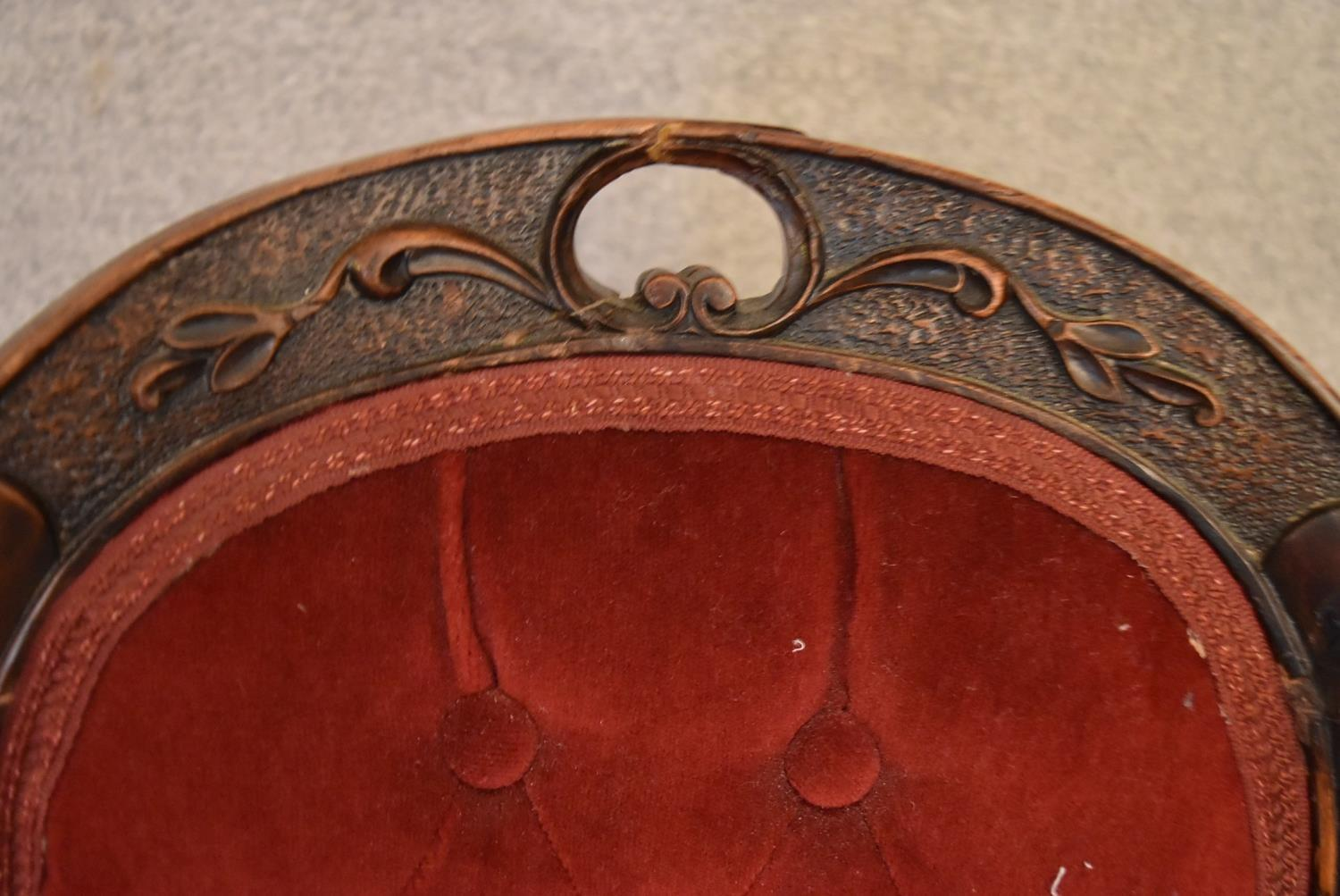 A Victorian mahogany framed balloon backed armchair on carved cabriole supports. H.85x43cm - Image 2 of 5