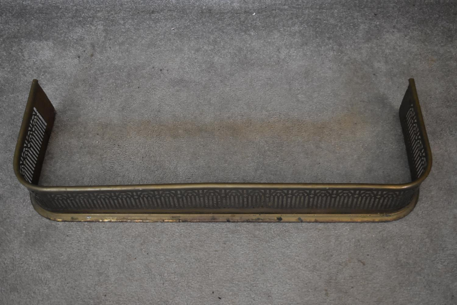 A 19th century pierced brass fire kerb. H.14x92x35cm - Image 2 of 3
