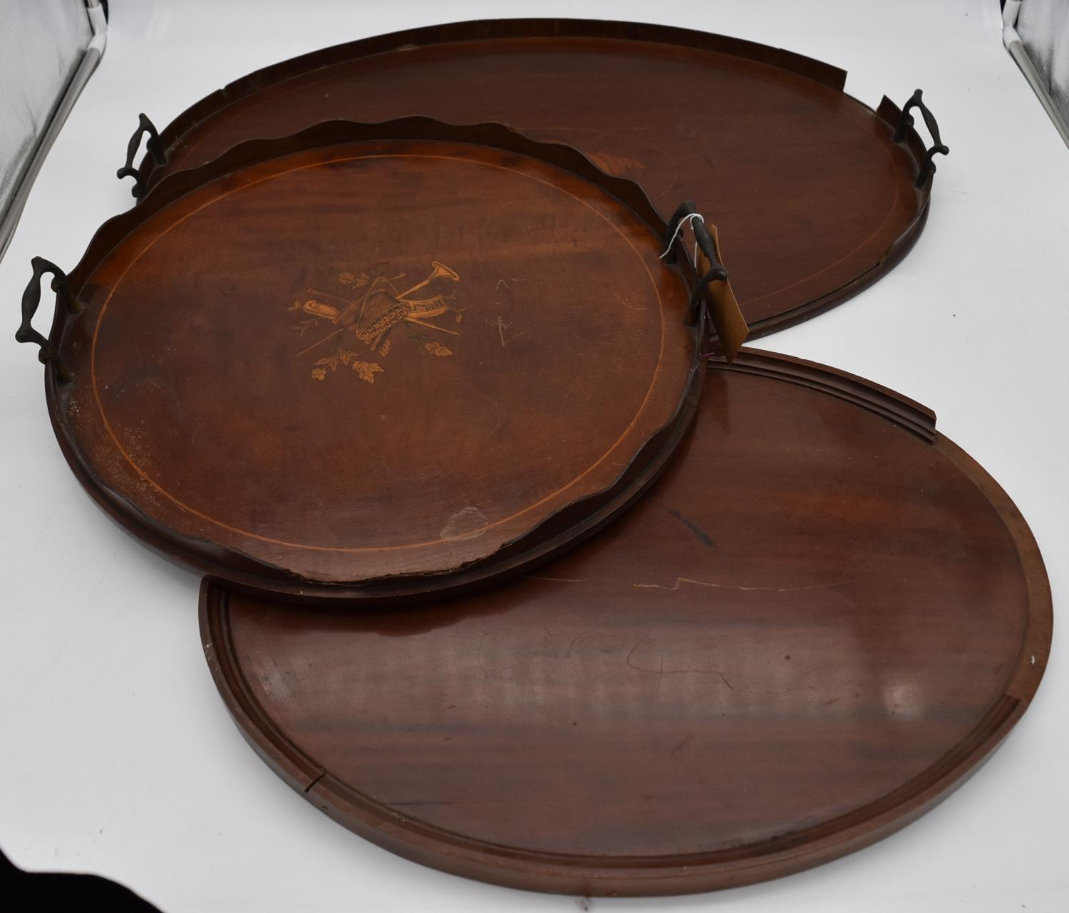 A late 19th century mahogany and satinwood inlaid twin handled tray and two other similar trays. L.