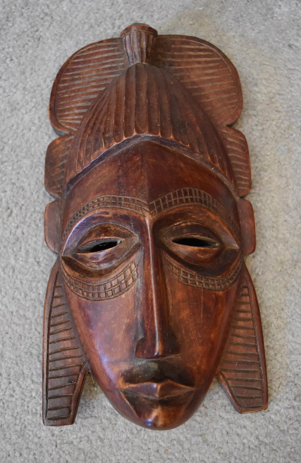 A small carved green hardstone African bust and a collection of various African tribal wooden - Image 4 of 7