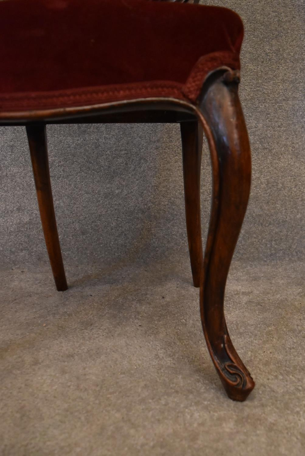 A Victorian mahogany framed balloon backed armchair on carved cabriole supports. H.85x43cm - Image 4 of 5