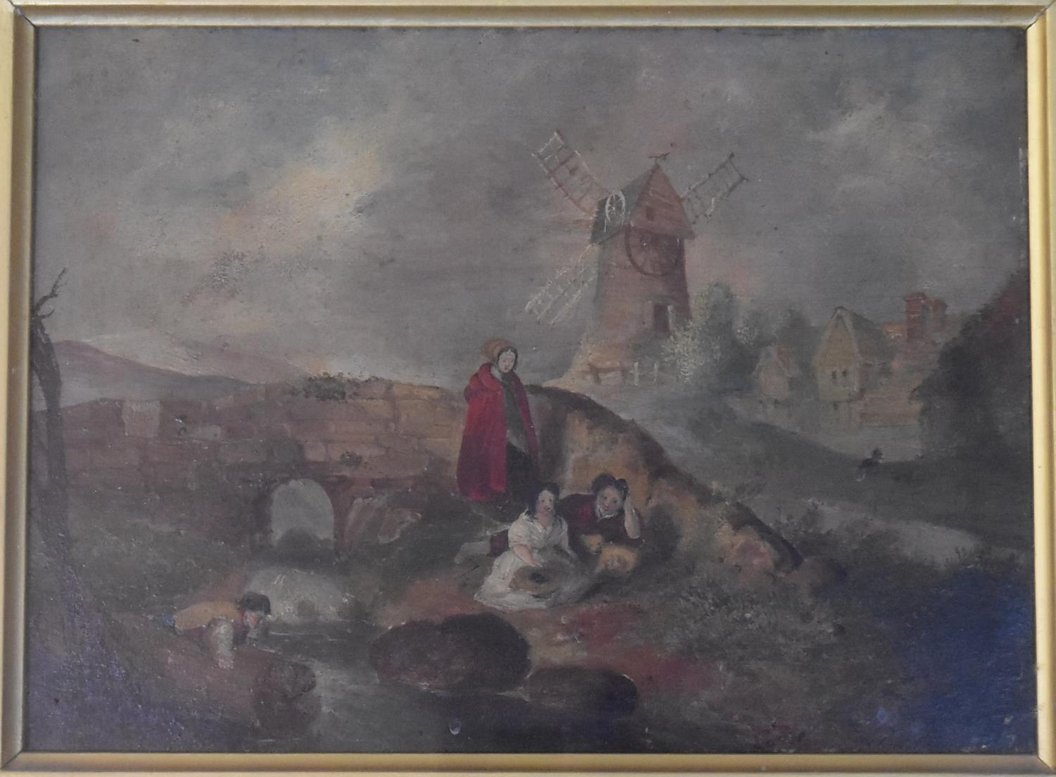 A gilt framed and glazed oil on board, windmill and village, figures in the foreground by a