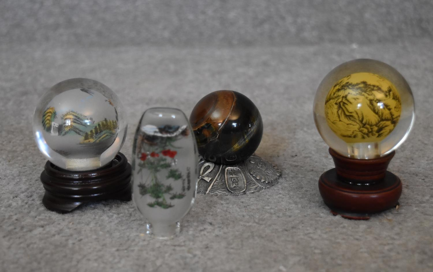 Two Japanese reverse painted globes with Japanese mountains and landscapes, a Japanese reverse