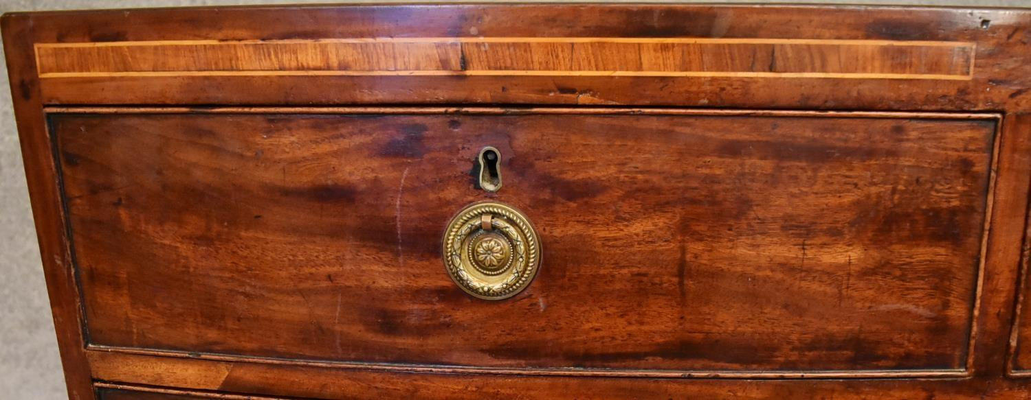 A Georgian mahogany and satinwood inlaid bowfronted chest of drawers on swept bracket feet. H. - Image 3 of 4