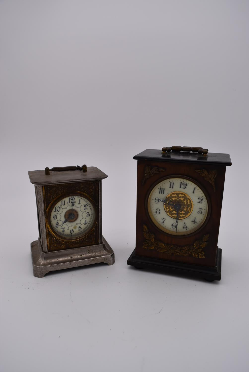 A brass cased carriage clock with engraved brass front with scrolling design and white enamel dial
