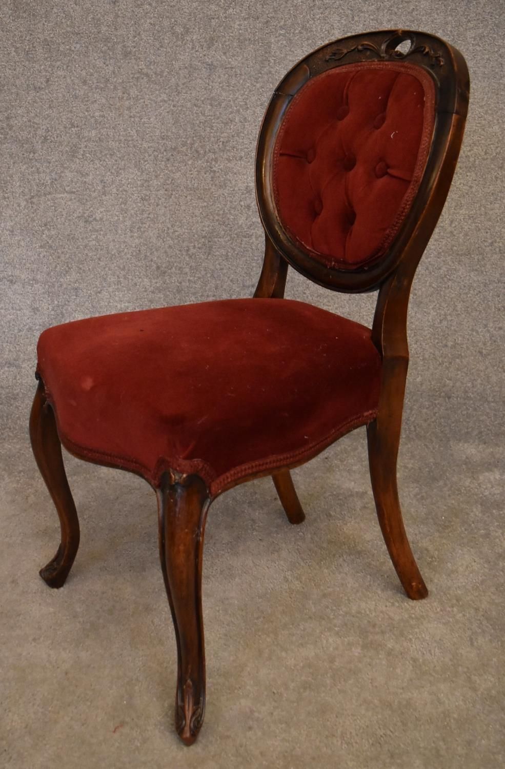 A Victorian mahogany framed balloon backed armchair on carved cabriole supports. H.85x43cm - Image 5 of 5
