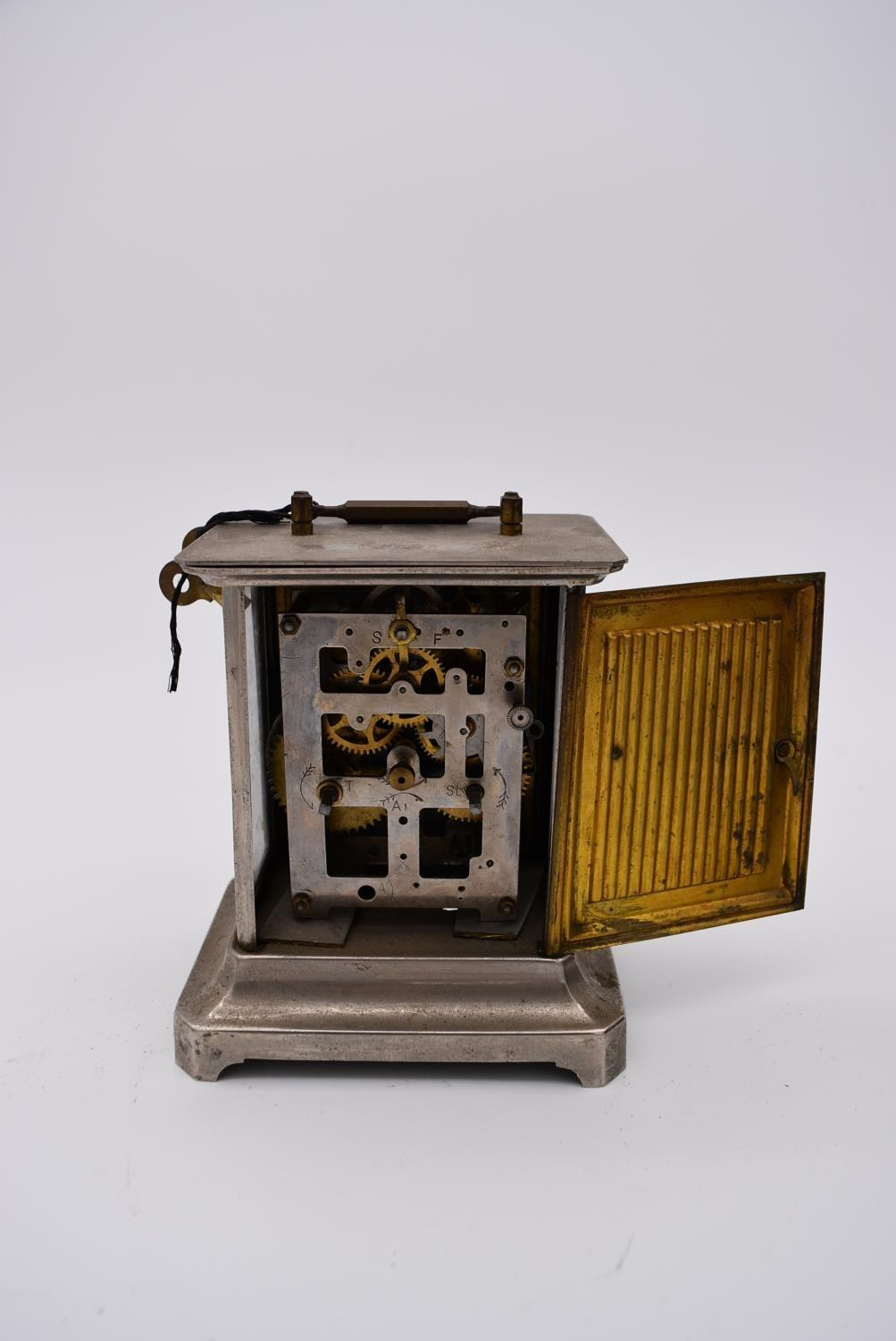 A brass cased carriage clock with engraved brass front with scrolling design and white enamel dial - Image 5 of 8