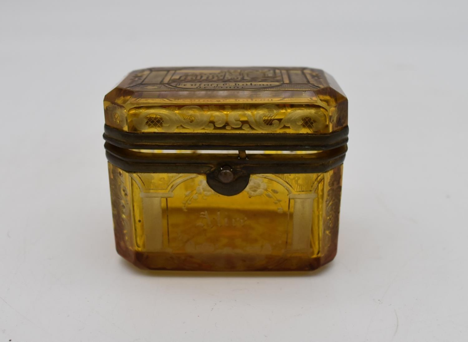 A small 19th century engraved amber glass and ormolu mounted box. H.7x8cm