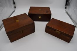 A 19th century walnut fitted box and two other similar boxes. H.14x28cm