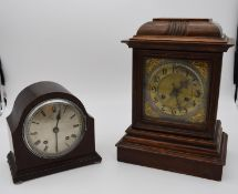 An oak cased bracket clock with brass dial and gilt metal pierced detailing to the corners and