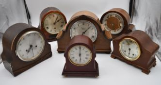 A miscellaneous collection of six mid 20th century mantel clocks. One by JW Benson of London. H.